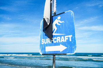 Surfcraft Sign on Beach