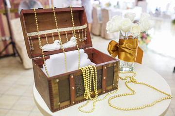 newlyweds gift box decorated with beads on the table
