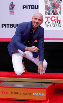 American rapper Pitbull attends a ceremony of placing his hands in cement in the forecourt of the TCL Chinese theatre in Los Angeles
