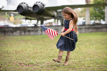 Smiling girl holding an American flag