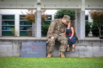 Daughter kissing her father