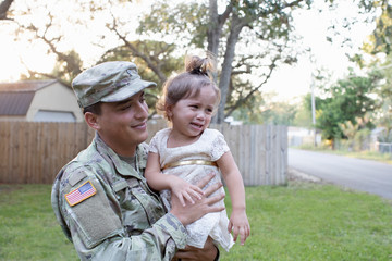 Soldier holding his daughter