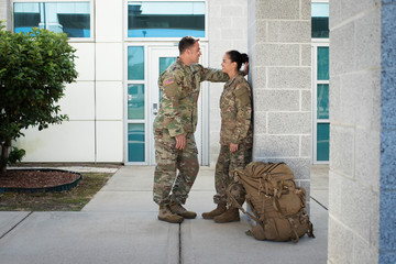 Two soldiers smiling and talking
