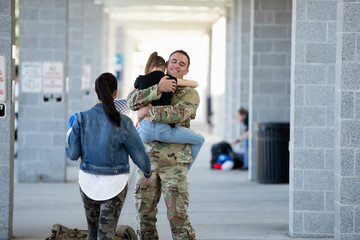 Soldier reuniting with his family