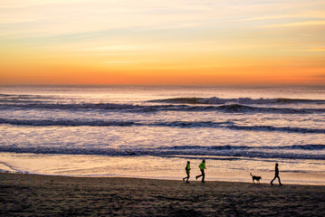 Runners At Sunset