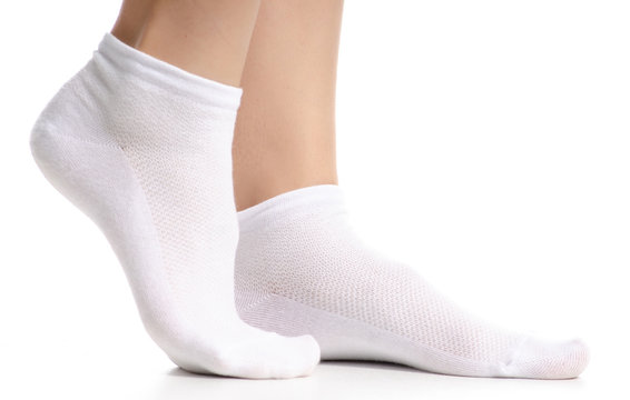 Female legs in white socks on white background. Isolation