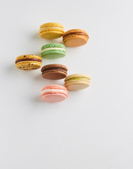 Colorful macaron cookies in on white background