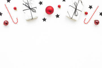 Christmas stars, decorations, gift on white background, flat lay, top view