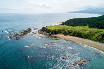 Aerial drone photo of cape Velikan (near by cape Ptichiy), Sakhalin island, Russia (Sahalin). Unbelievable natural green lawns