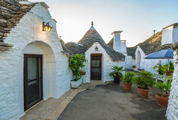 Wall Mural - Traditional Trulli houses in Alberobello city, Apulia, Italy
