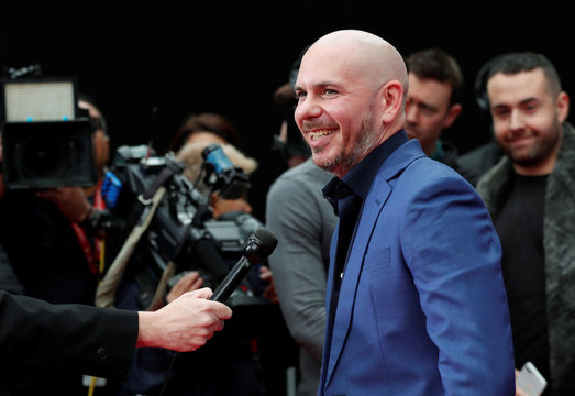 American rapper Pitbull talks with the media after a ceremony of placing his hand and footprints in cement in the forecourt of the TCL Chinese theatre in Los Angeles