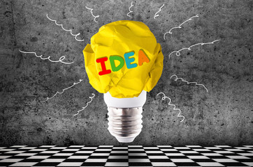 Wall Mural - crumpled yellow paper light bulb with colorful inscription idea, inspirational image