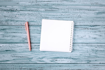 blank note book with pink pen