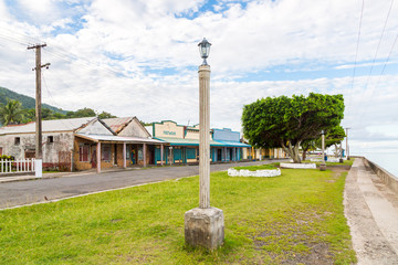Colourful empty seafront of old colonial capital of Fiji - Levuka town, Ovalau island, Lomaiviti archipelago, Fiji, Melanesia, Oceania, South Pacific Ocean. Street light pole. UNESCO world heritage