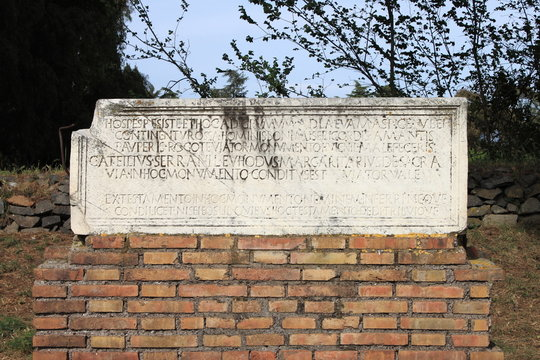 Ancient latin inscription in the Appian way of Rome, Italy