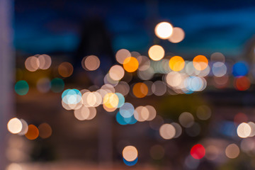 Bokeh texture. Green, yelow, orange, blue, red circles. Slight onion ring effect is present. Car lights different colors bokeh.