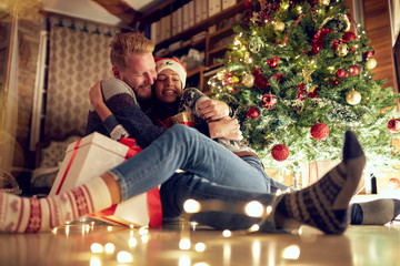 tradition gift for Christmas- couple in love at Christmas night .