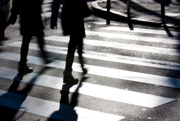 Blurry zebra crossing with pedestrians