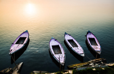Boats along the Ganges River at sunset in Varanasi, India