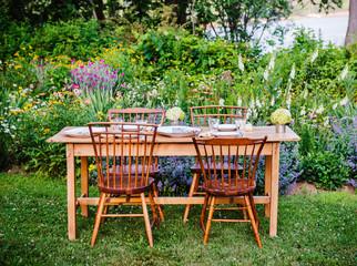 Summer New England dinner in flower garden