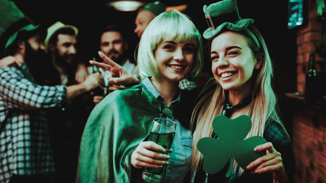 Two Girls In Carnival Clothes. St Patrick's Day.
