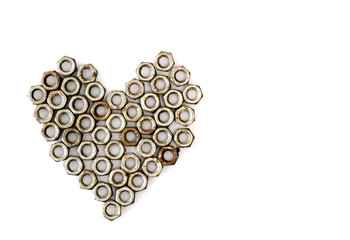 Heart shape of rusty bolts on white background