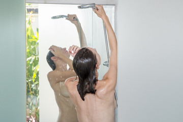 Poster Akt Young woman taking a shower, wellbeing, body care and beauty concept