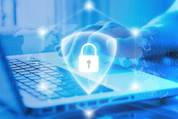 Cybersecurity and GDPR concept. Secure online payments via Internet. Hand using computer with lock and shield on background. Authorization access to network.