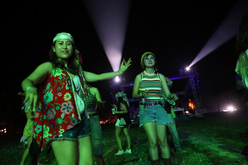 People attend a band performance at the Wonderfruit art festival in Pattaya