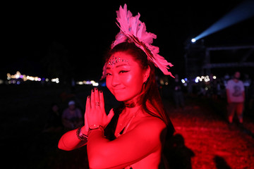 A woman attends a band performance at the Wonderfruit art festival in Pattaya