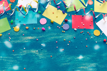 Festive bright blue background decoration for holiday colored confetti serpentine paper gifts box The view from the top was lying flat copyspace