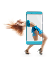 Beautiful graceful belly dancing woman on smartphone s screen. conceptual image with a smartphone, demonstration of device capabilities