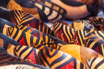 Tribal colored bowls in street market souvenir store in South Africa