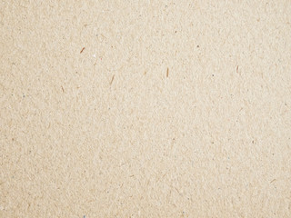 Texture of beige cardboard closeup, abstract paper background