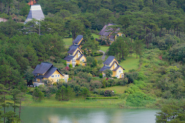luxury resort next to the lake in pine forest with fresh air, nature, relaxing at dawn. Photo taken in Dalat, Vietnam