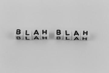 """word of blocks """"blah blah"""" on white background"""