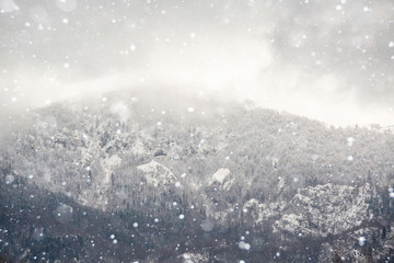Snowfall in winter mountains