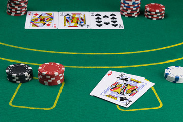 green poker field with cards and chips