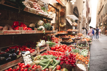 Beautiful fresh vegetables are sold in the street market on the narrow streets of the European town. Fresh vegetables are sold on the streets of Florence, Italy
