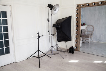 Interior of PhotoStudio flashes white grey background decor