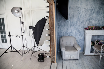 Interior of PhotoStudio flashes white grey background decor