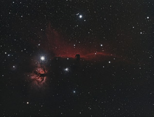 Horsehead Nebula and the Flame one in Orion constellation, taken by refractor telescope at 450 milimeters of focal length and many stars as background.