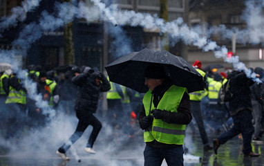 """Tear gas floats in the air during clashes with police at a demonstration by the """"yellow vests"""" movement in Nantes"""
