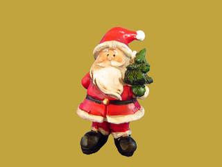 Weihnachtsmann mit Weihnachtsbaum in der nehmenden Hand, die gebende Hand auf dem Rücken , alle Jahre wieder, kommt Gott auf die Erde nieder, 2018 ganz bescheiden