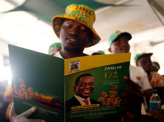 A delegate attends the closing session of the ruling party ZANU PF's annual conference in Esigodini, outside Bulawayo