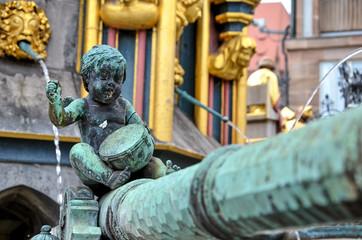 Wall Mural - Bronzefigur am Schönen Brunnen in Nürnberg