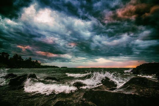 Colorful Storm Clouds Over Turbulent Sea. Dramatic Cloudscape and Seascape Background with Copy Space. Stormy sky over Lake Superior in Michigan's Upper Peninsula. Moody stylized seascape.