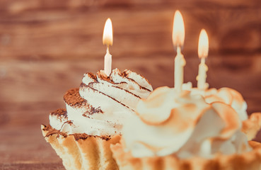 Sweet cupcakes with burning candles.