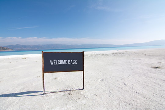 Welcome back text on a board Beach, Coast in Turkey