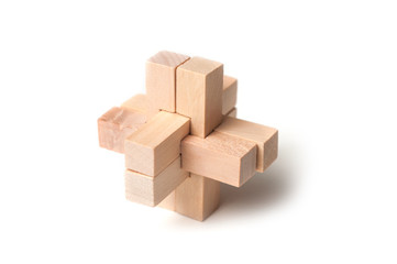 closeup of solved wooden puzzle  on white background Fototapete